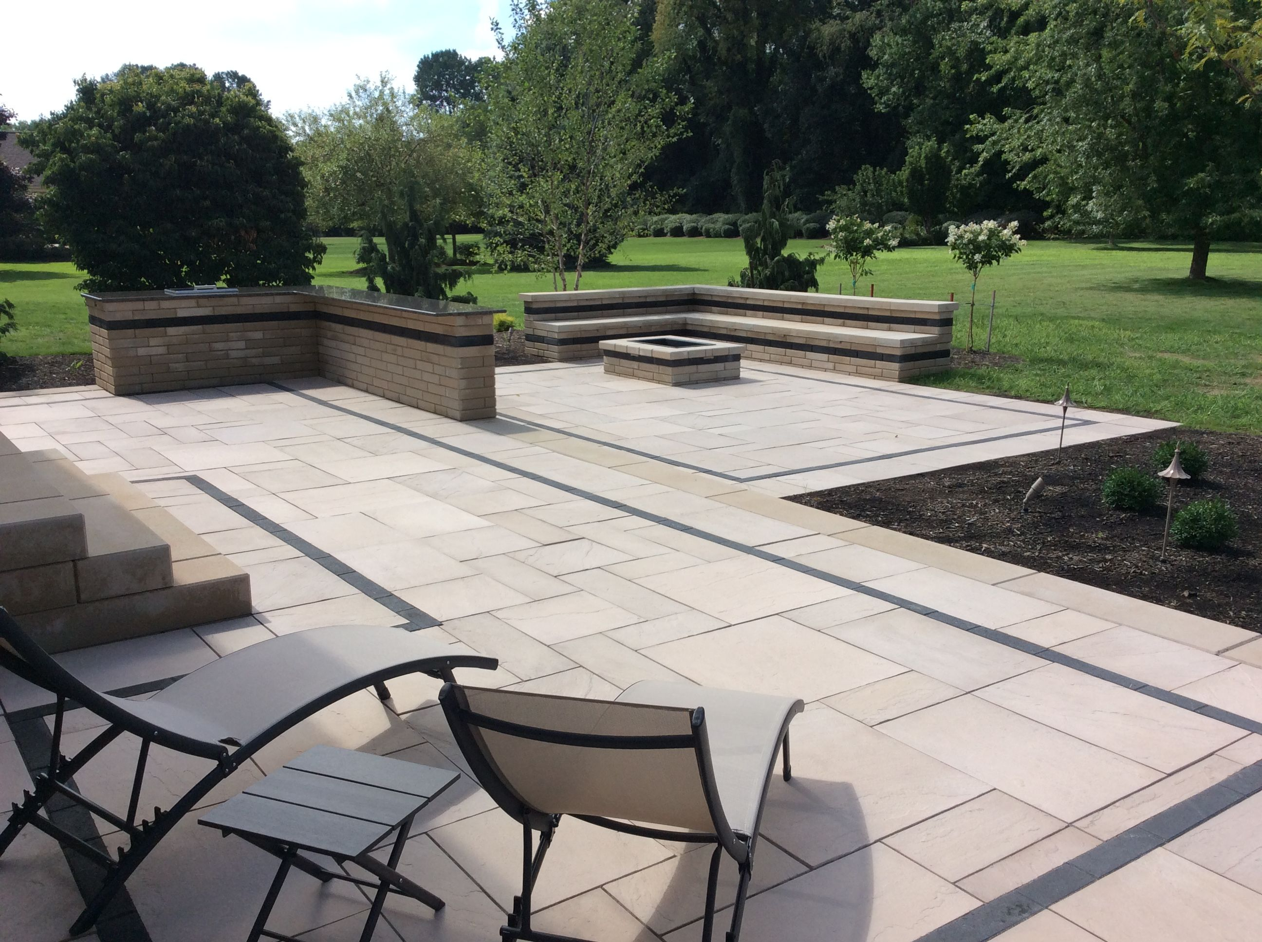 1 100sf two tiered paver patio with 10ft long bar drop in for Techo bloc