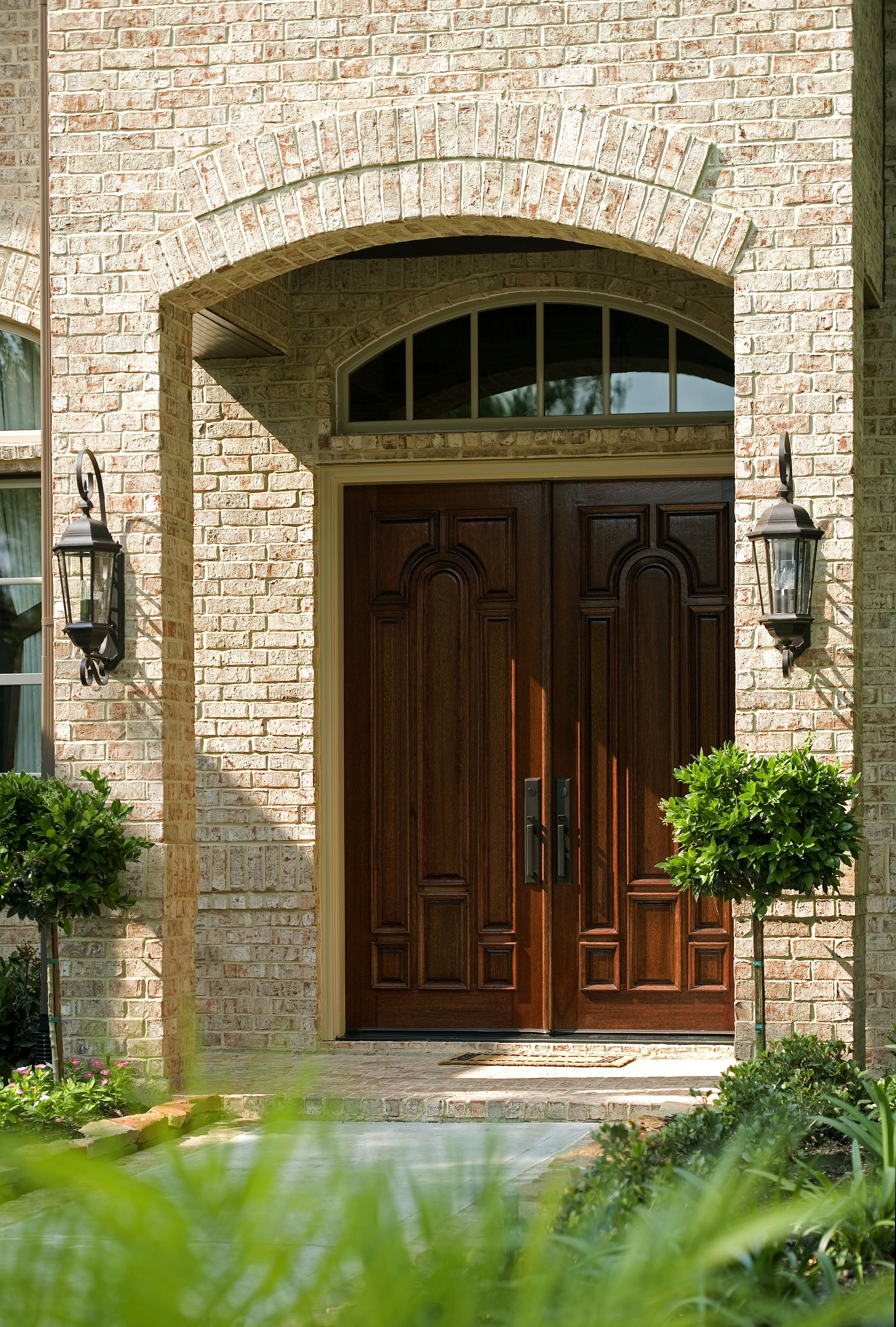 Large Double Wooden Door With Oil Rubbed Bronze Hardware White Brick Transom Windows Above And A Traditional Design If You Are Thinking About Adding