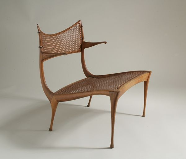 """Gazelle Lounge Chair, Model no. 30W Dan Johnson Studio USA, c. 1957 Italian walnut, cane and brass H. 28 in.; W. 23 1/4 in.; D. 26 in. Retains its original caning on seat. The unique low design of this particular chair indicates it may have been a prototype.  PROVENANCE Wright 20 Auctions, """"Modern Design,"""" 20 March 2005, lot 338, sold for $15,000"""