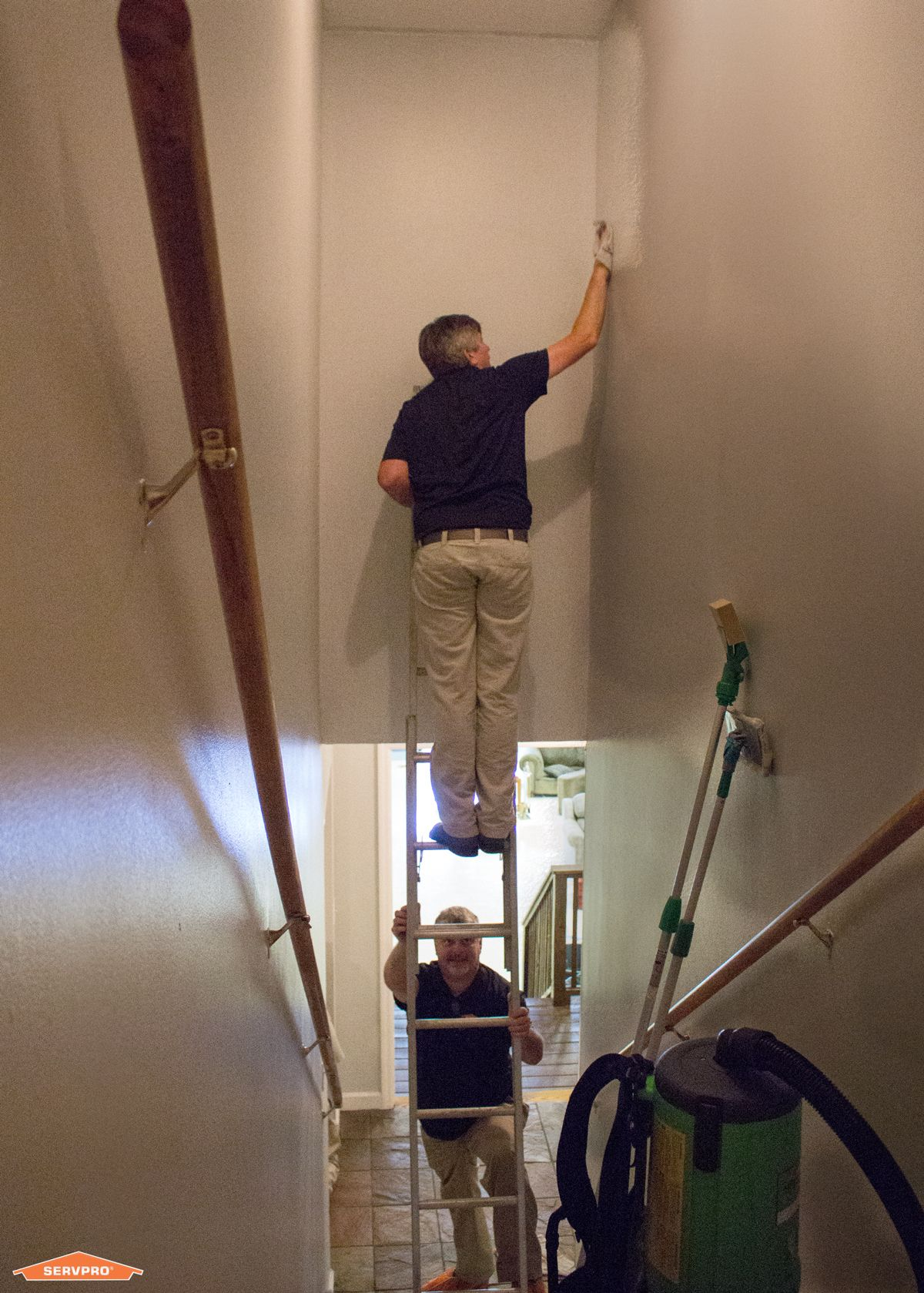 Servpro Team Members Cleaning Soot Off Of The Walls Of A House After A Fire Residential Cleaning Services Cleaning Service Residential Cleaning