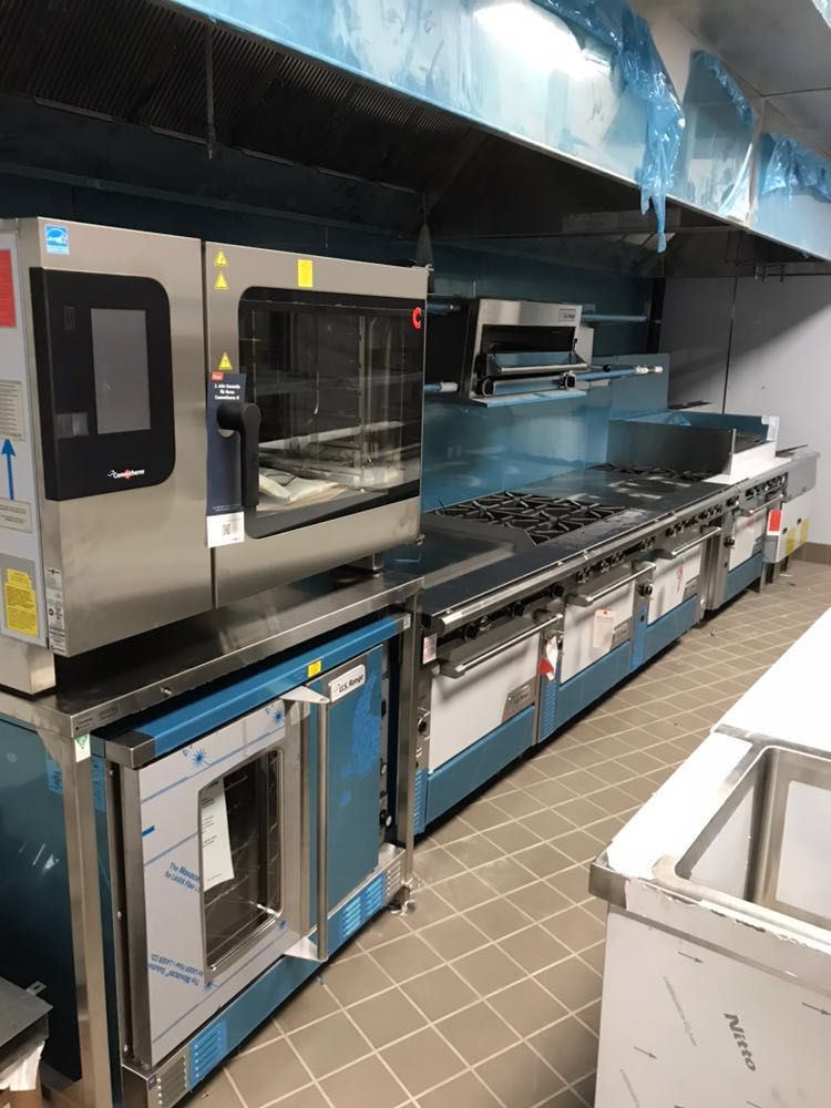A Commercial Kitchen Fully Stocked With New Equipment Https Www