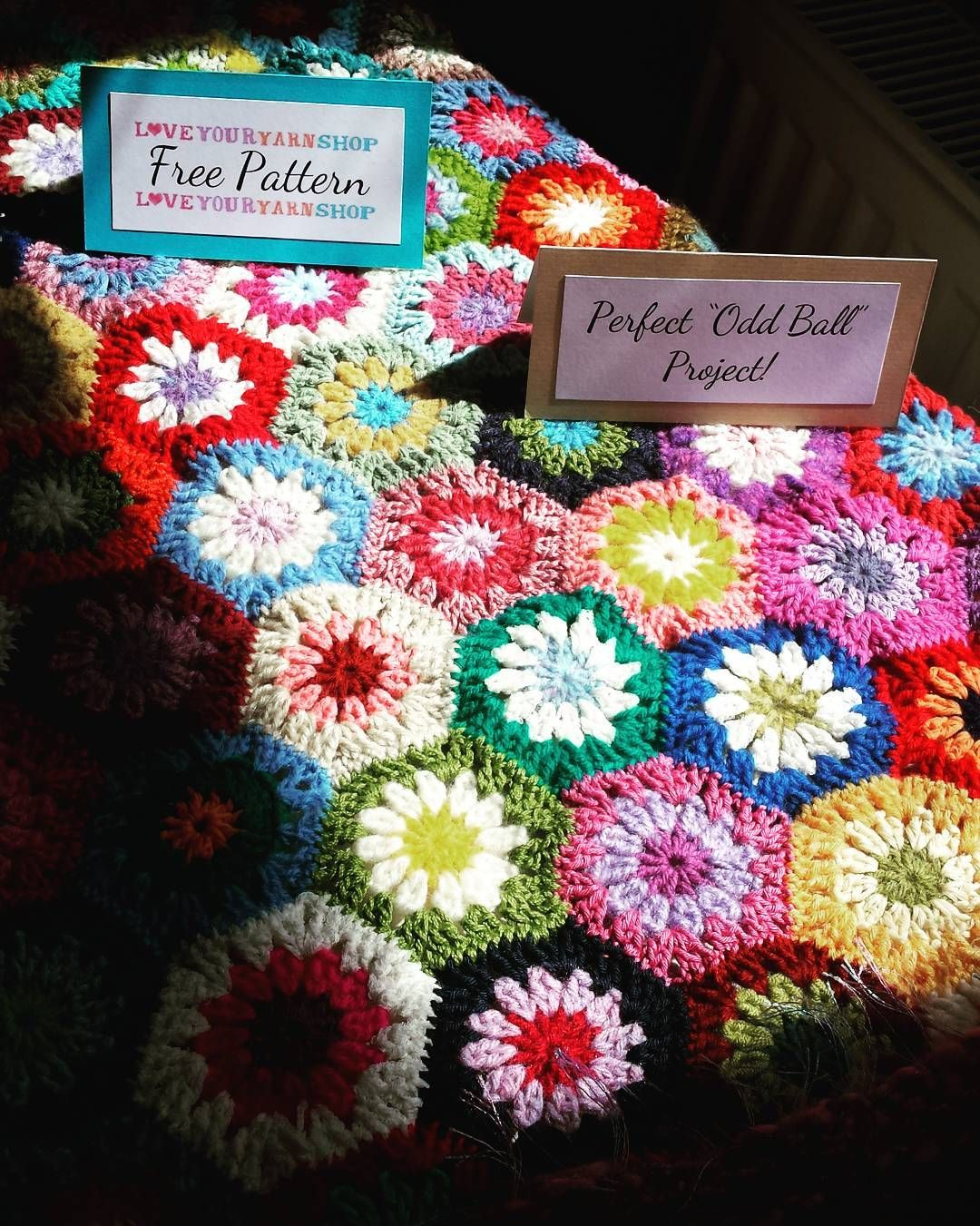 Our Yarn Shop Day with @letsknitmag and Julia's House tomorrow is full of colourful & inspirational ideas like this Crochet Hexagon blanket in pride of place by the window and it just looks amazing as the Sturminster Newton sun shines down on it!  #yarnshopday #colourful #inspiration #crochet #crochethexagon #colourfulyarn #blanket #prideofplace #sturminsternewton #sunshine #freepattern #oddball #project #YSDathansons by hansonsfabricsandcrafts