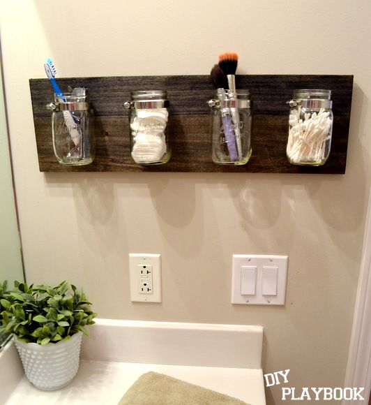 Mason jar bathroom organizer...I have some blue Mason jars I want to do this with.