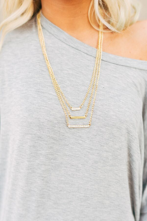 """We know you guys love accessories that raise the bar and you better believe this necklace does just that! With tiered and rhinestone studded bars, this piece is sure to get a second glance. Imported 