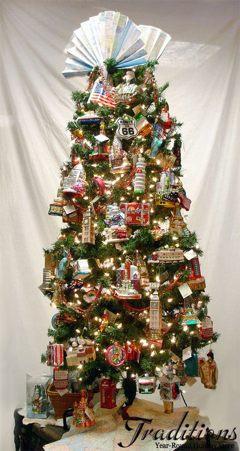 Our Travel Tree Filled With Lots Of Ornaments