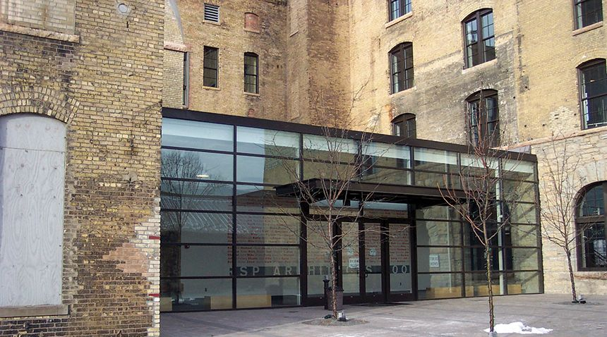 One story glass addition with black metal frames between wings of a buff  brick historicOne story glass addition with black metal frames between wings of  . Brick Apartment Building Entrance. Home Design Ideas