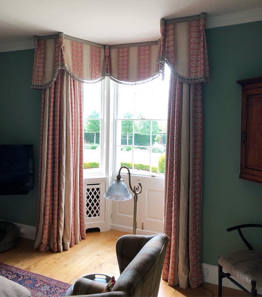 A Soft Pelmet With A Shaped Bottom Edge Frames A Bay Window In A