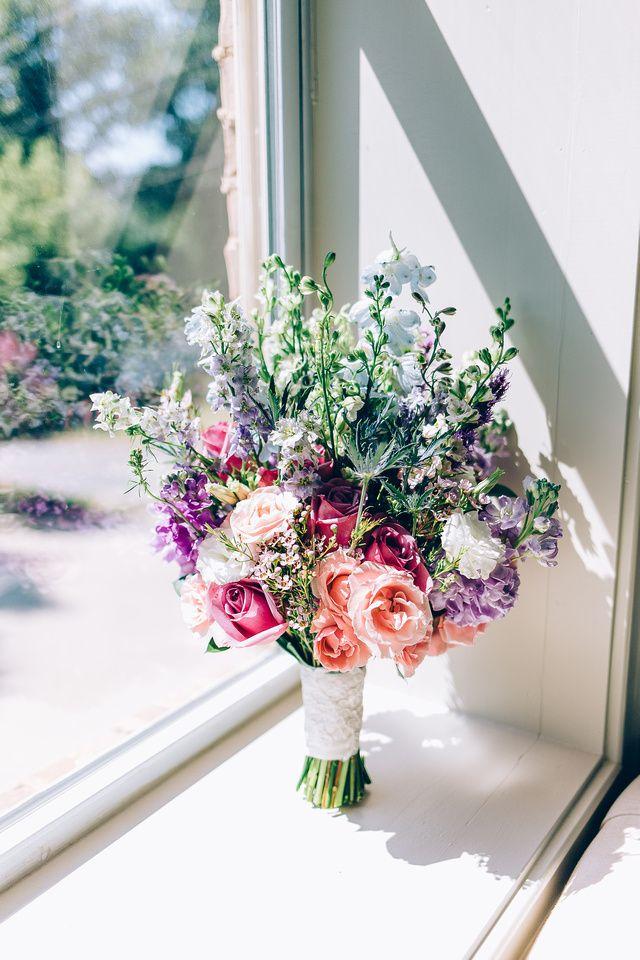 Bridal bouquet made of roses, stock, larkspur, delphinium, and blue thistle. #weddingflowers #wedding #bouquet #bridalbouquet