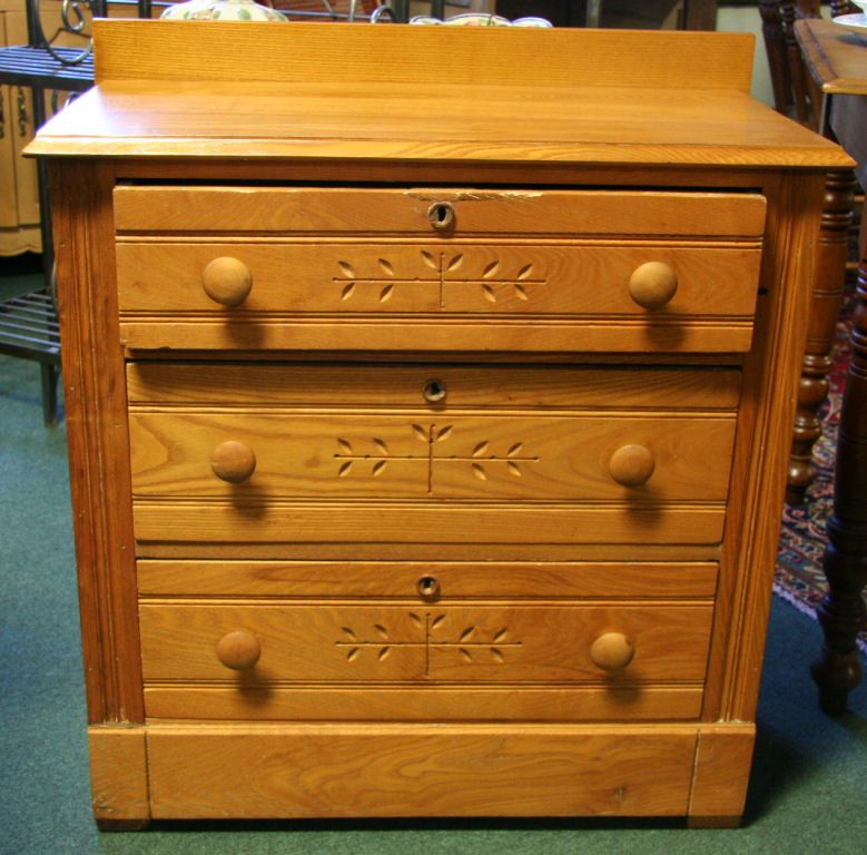 Eastlake Victorian chest of drawers with characteristic