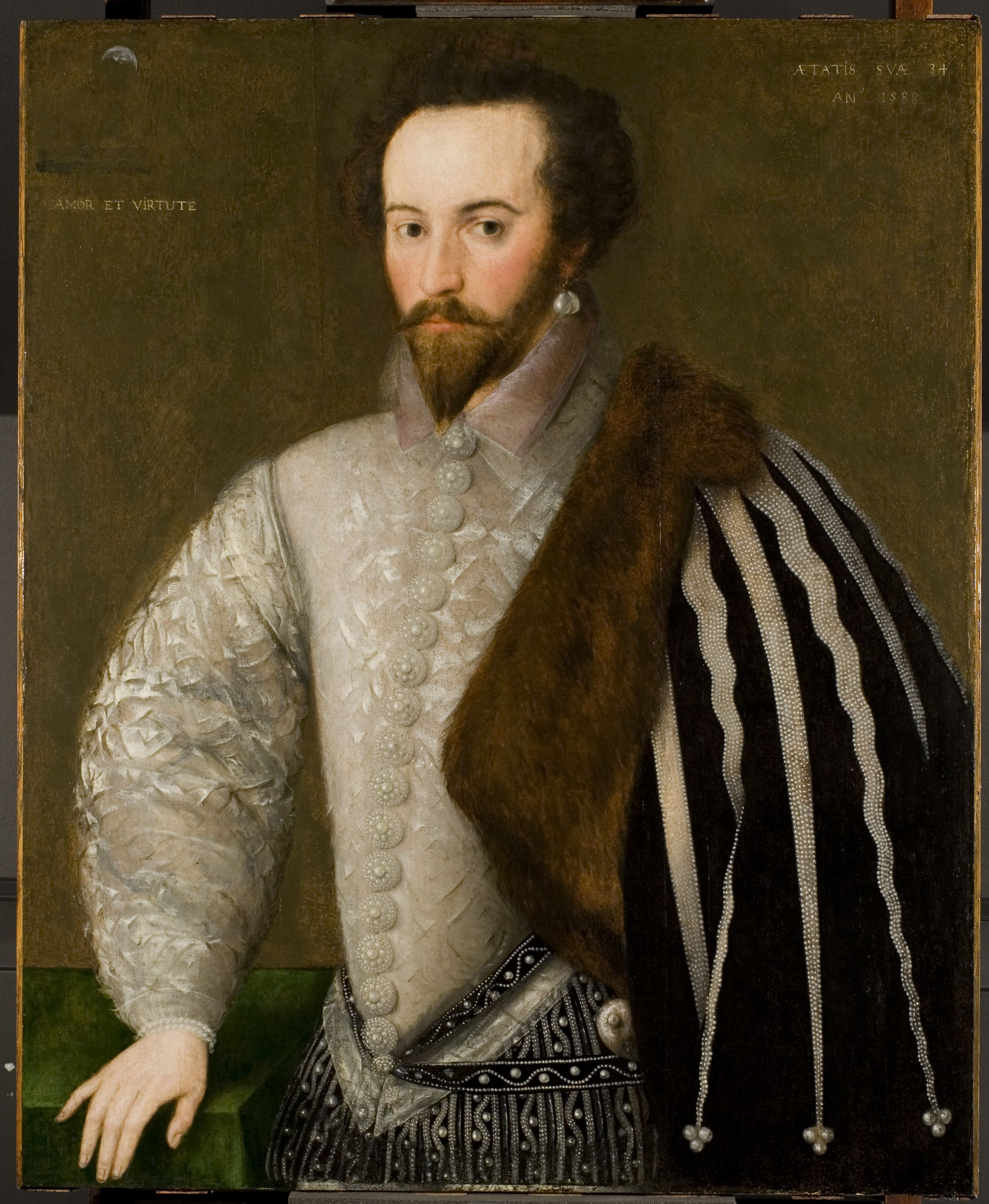 A Portrait Of Sir Walter Raleigh, Explorer, Soldier, Poet And Favored  Courtier Of Queen Elizabeth I, In The National Portrait Gallery Has An  Allegorical ...