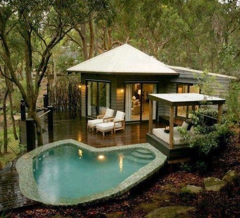 its all about outdoor living at this sweet little cabin with an expansive deck and poolside