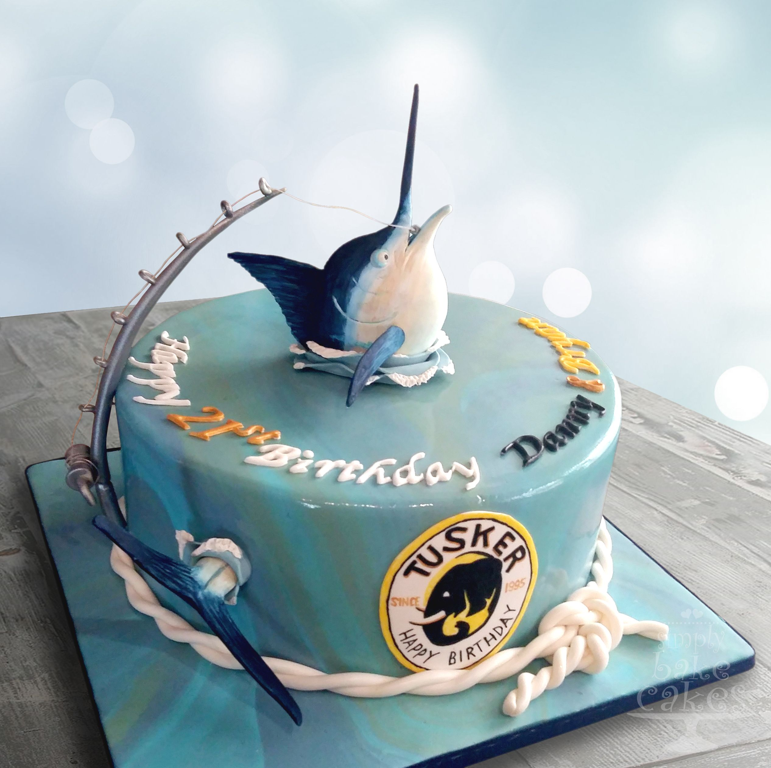 Fishing themed cake with gum paste blue marlin and fishing rod