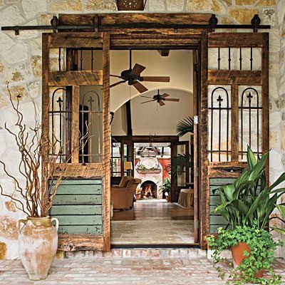 distressed wooden sliding door something like this would make a great garden gate into an