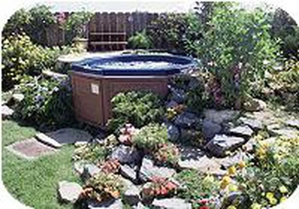 Hot Tub Tucked In A Garden Corner I Really Like The Idea Of Doing A Rock Garden Around The Tub Hot Tub Landscaping Hot Tub Backyard Hot Tub Outdoor