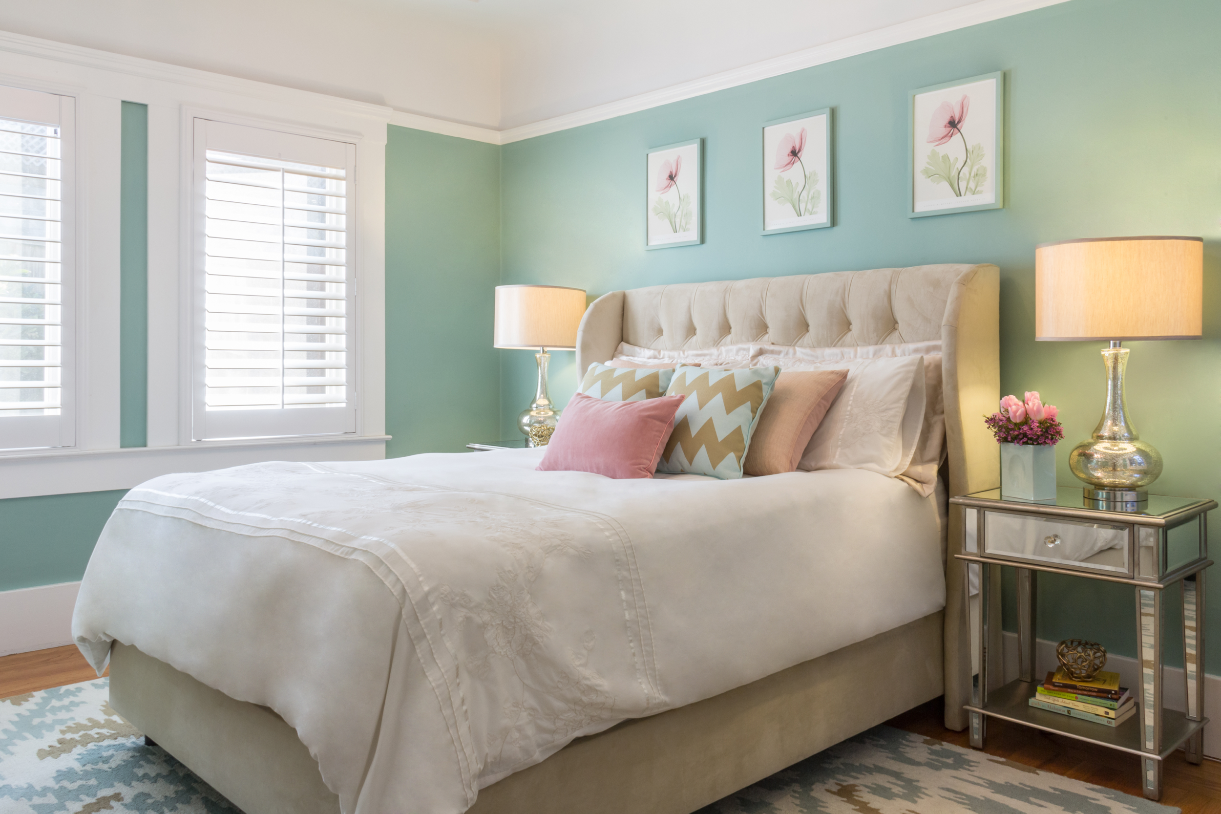 Bedroom with pops of green and pink to give vibrancy and feminine flair