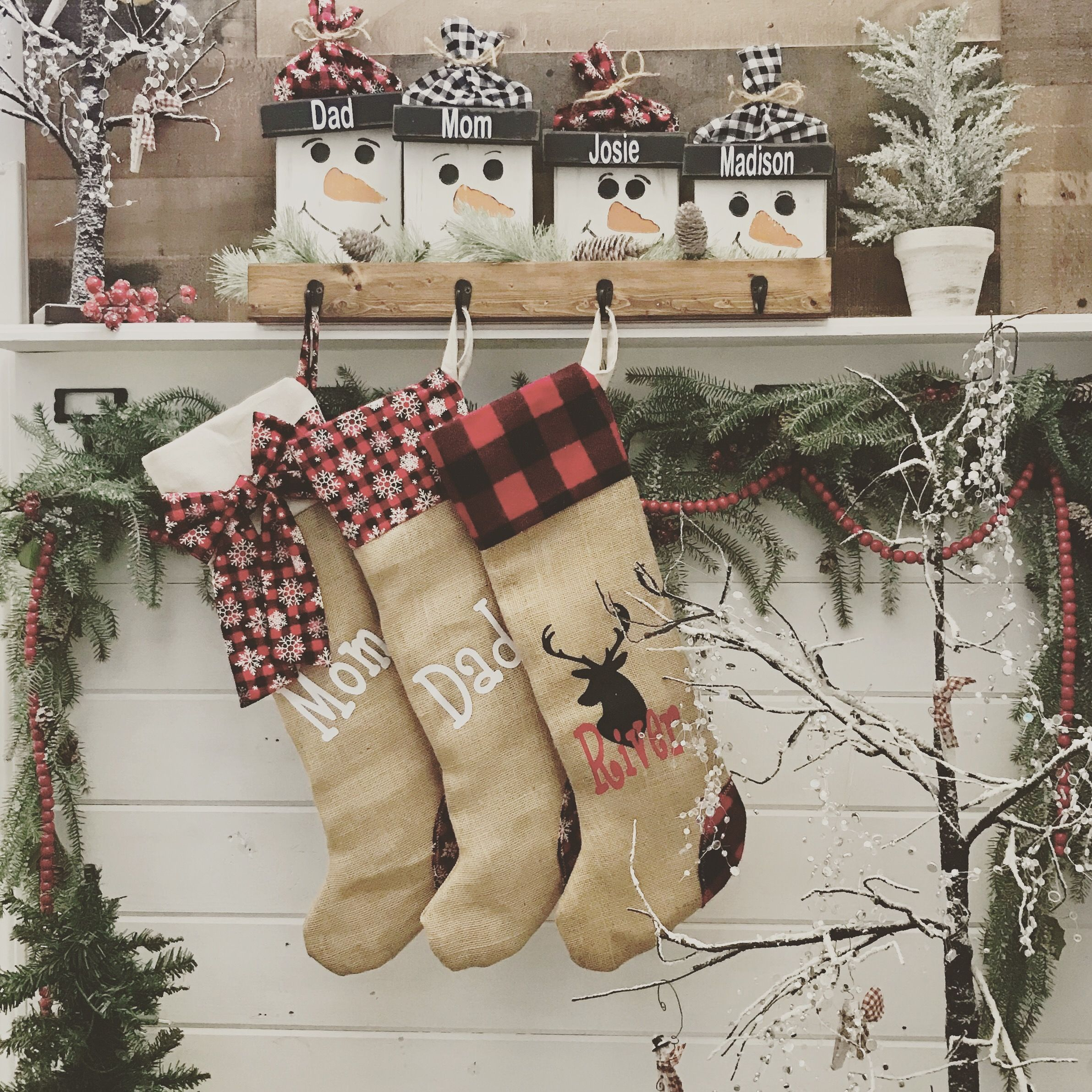 This snowman stocking holder will add a special rustic ...