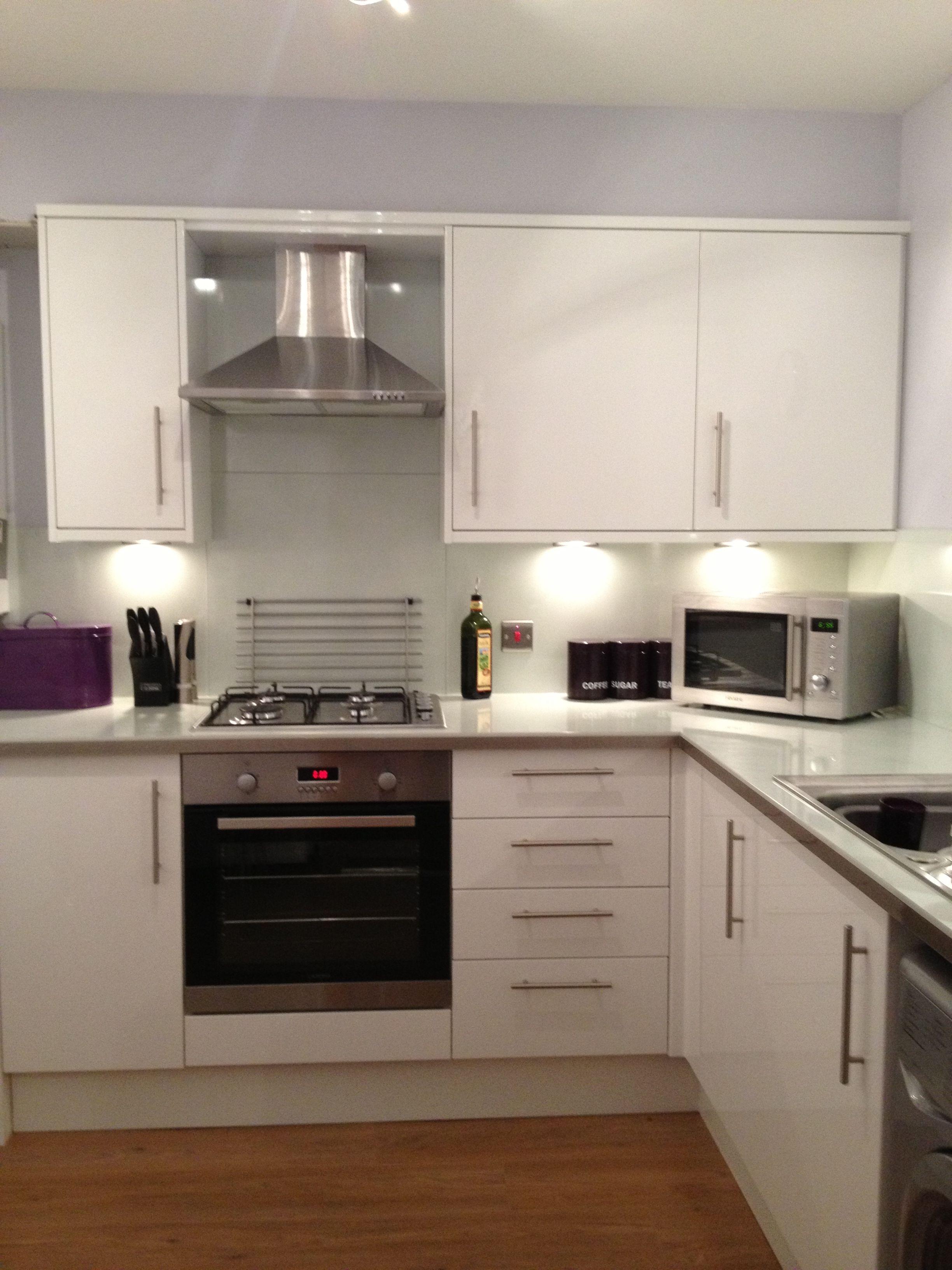 beautiful white high gloss kitchen  glass worktop