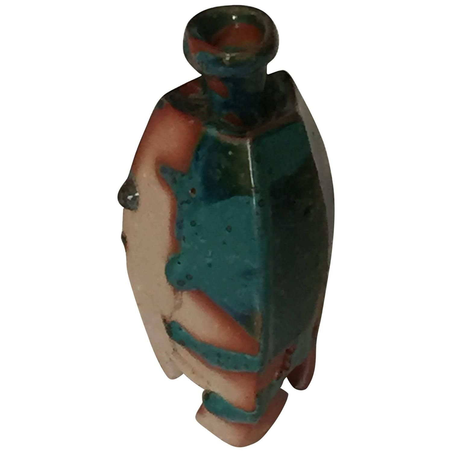 Contemporary Sake Bottle by Kakurezaki Ryuichi   This Bizen tokkuri sake flask is characterized by the flow of green glaze over the red and natural clay body. Four sided and standing on three legs.