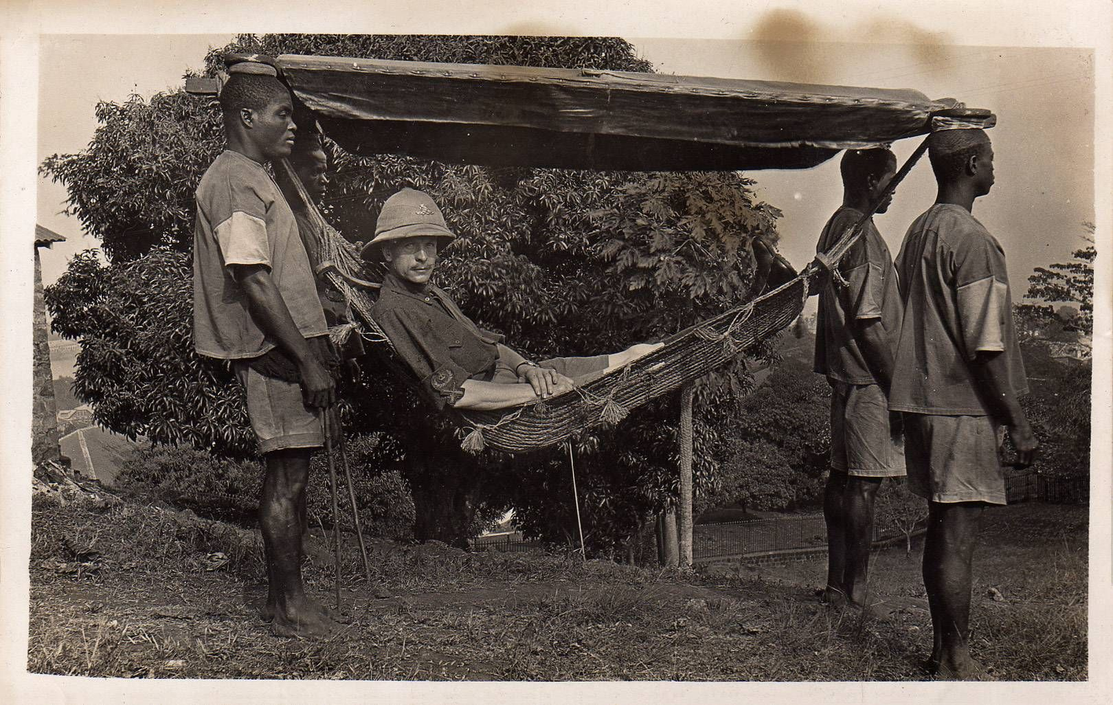 a british army officer carried in a hammock 1920 life is a hammock british colonial being carried on his hammock by his servants      rh   pinterest