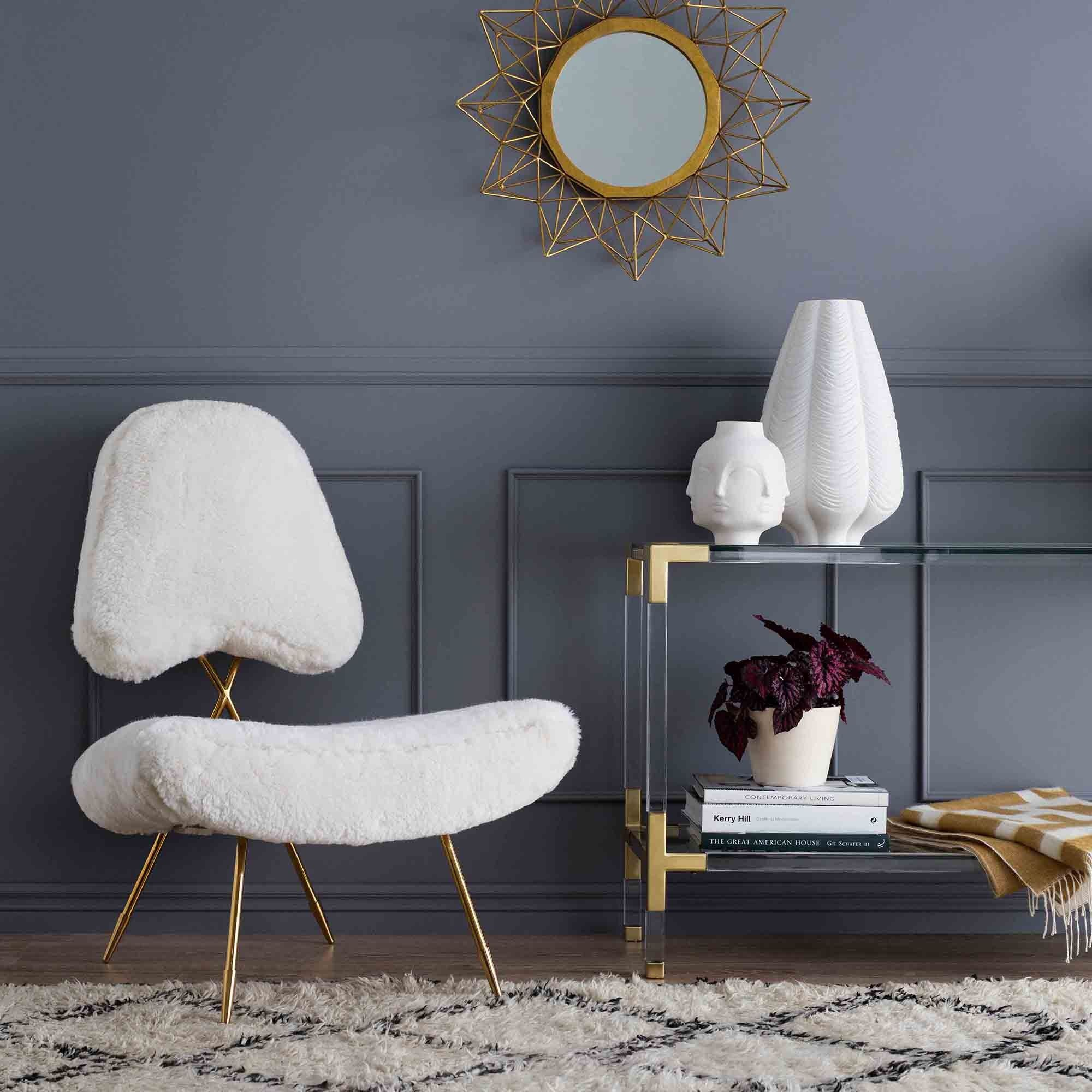 Jonathan Adler minimalist lounge chair with glamourous details and comfort-minded form.