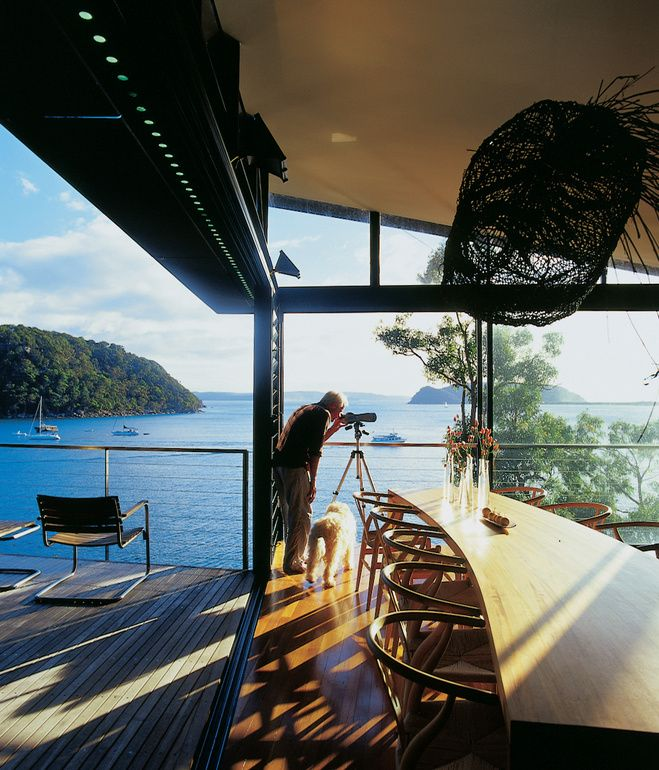 The James-Robertson house is composed of three separate structures perched in trees overlooking Australia's Pittwater Bay. With a bird's-eye view of its surroundings, smooth wood floors, and open decks that integrate common rooms with the outdoors, the home combines luxury with a natural experience. Photo by Richard Powers.