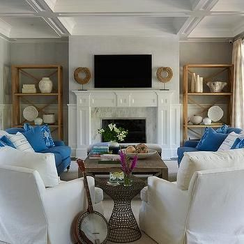 White And Blue Living Room With U Shaped Furniture Arrangement