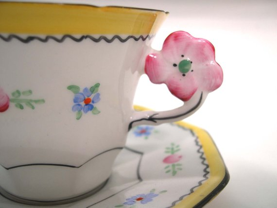 Rare tea cup and saucer from MelbaBright pink flower handle.HandpaintedThe saucer  has an octogonal shape.The set was made between  1948-1951Cup Measures: 2 3/4