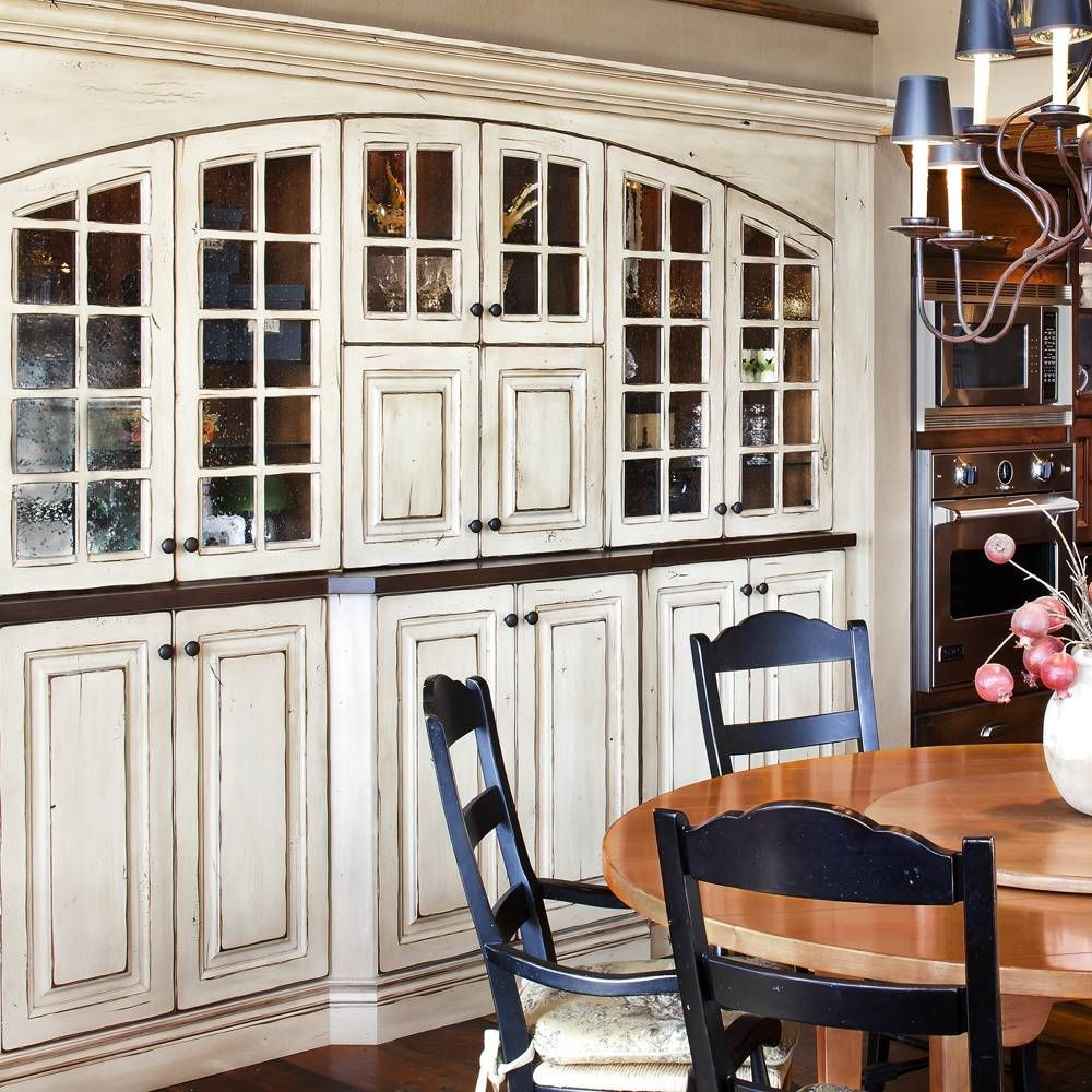 Built In China Cabinets In The Dining Room Love The Distressed White Painted Cabinet Semi Custom Kitchen Cabinets Custom Kitchen Cabinets Paint Cabinets White