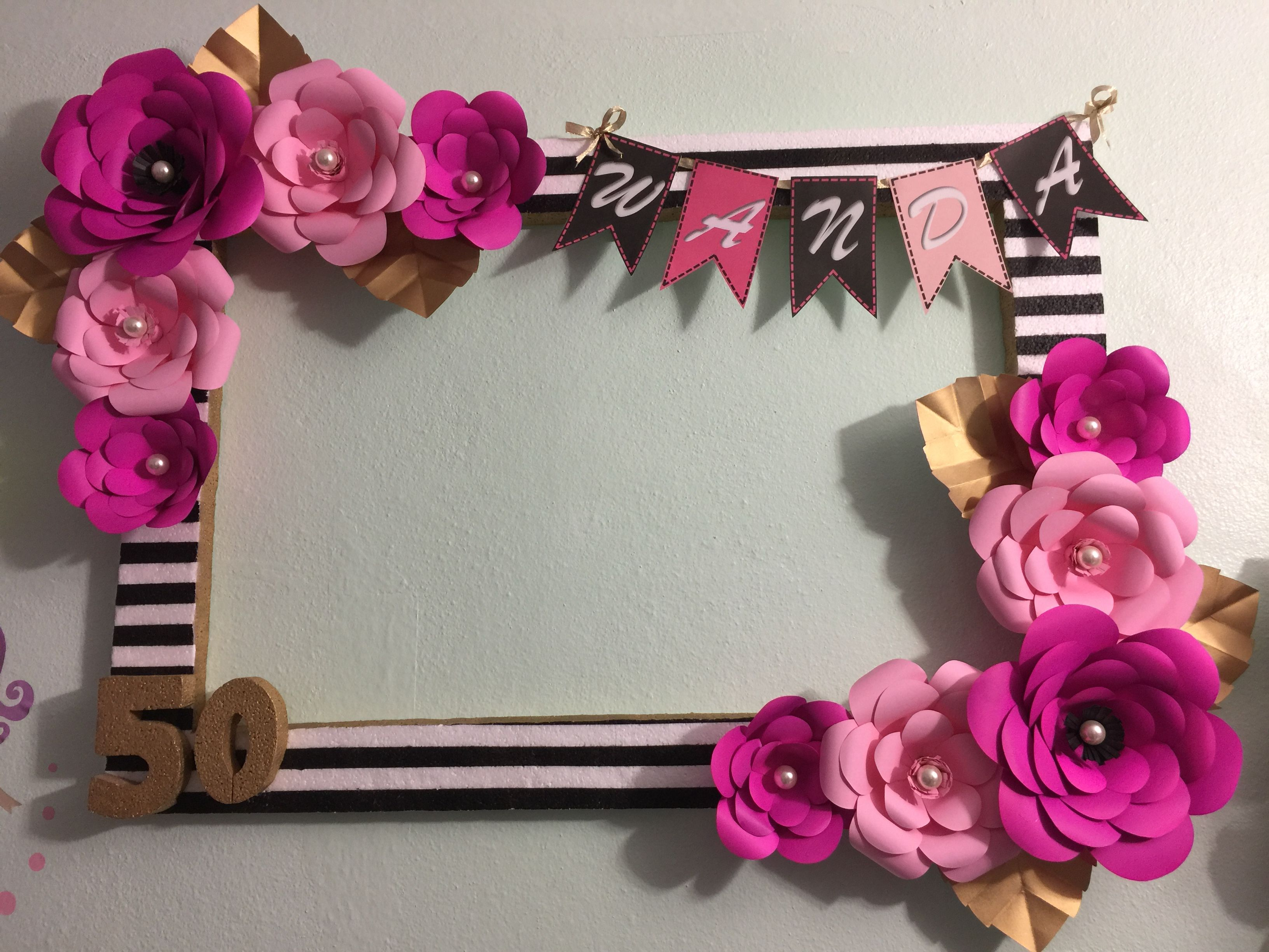 Black stripes and paper flowers in hot pink and pink photo booth ...