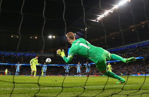 Joe Hart of Manchester City saves a penalty from Lionel Messi of Barcelona during the UEFA Champions League Round of 16 match between Manchester City and Barcelona at Etihad Stadium on February 24, 2015 in Manchester, United Kingdom