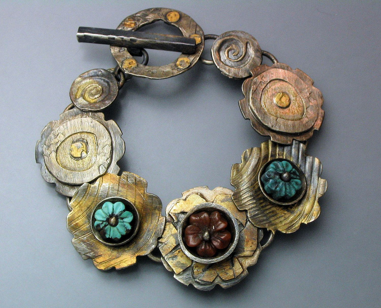 Bracelet | Temi Kucinski.  Sterling silver, patina and flowers carved from Carnelian and Turquoise