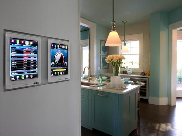 A launch port adjacent to the kitchen houses two smart tablets that allow the homeowner to control the homes security systems; heating and cooling; lighting;...  A launch port adjacent to the kitchen houses two smart tablets that allow the homeowner to control the homes security systems; heating and cooling; lighting; the whole-house audio system; shading and swimming pool functions; plus energy monitoring.