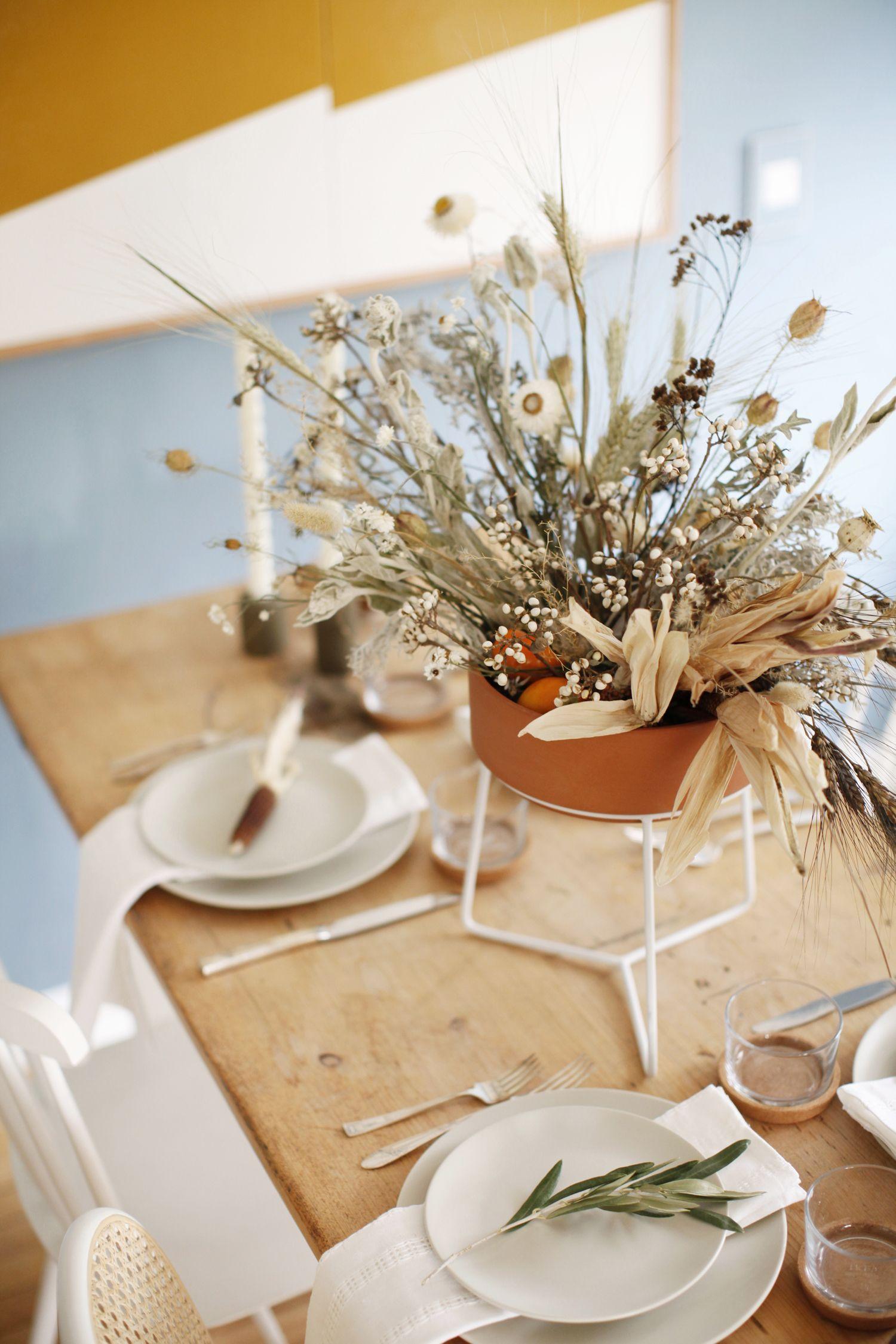 An organic modern thanksgiving tabletop with farmhouse