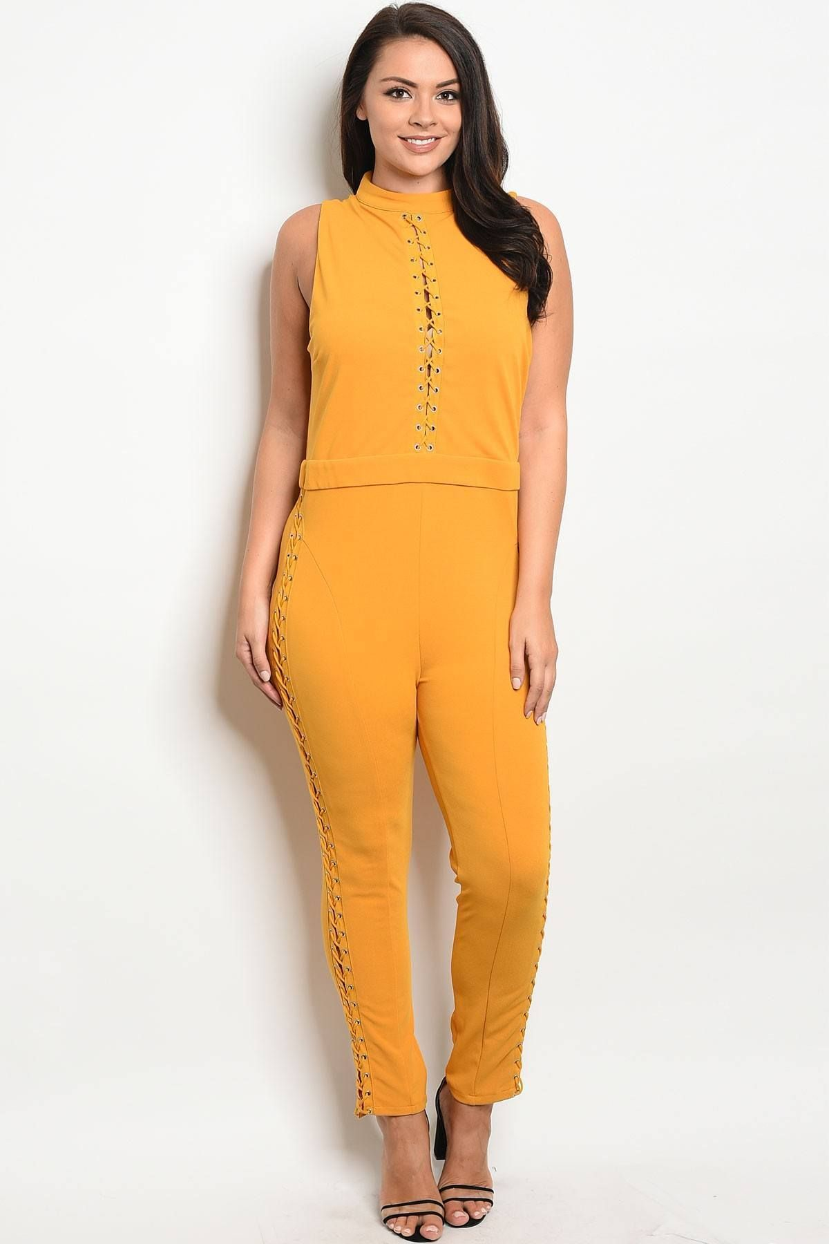 2301415ec73 Ladies fashion sleeveless fitted jumpsuit with a mock neckline and lace up  details Imported 1XL.2XL.3XL95% Polyester 5% Spandex Mustard WFS Ladies  fashion ...