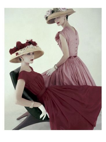 Two models wearing spring hats by Mollie Parnis in this Karen Radkai photograph, for the April 15, 1956, issue of Vogue.