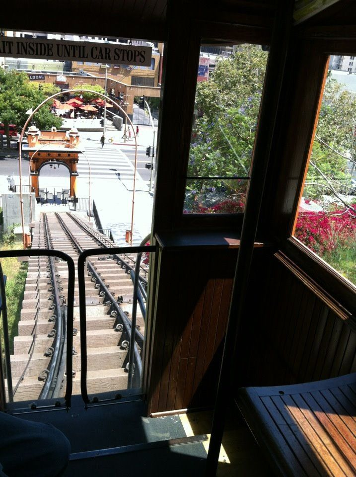 The View From Inside Of Angel S Flight Looking Down On The Entrance To Grand Central Market Angel Flight La Trip Entrance