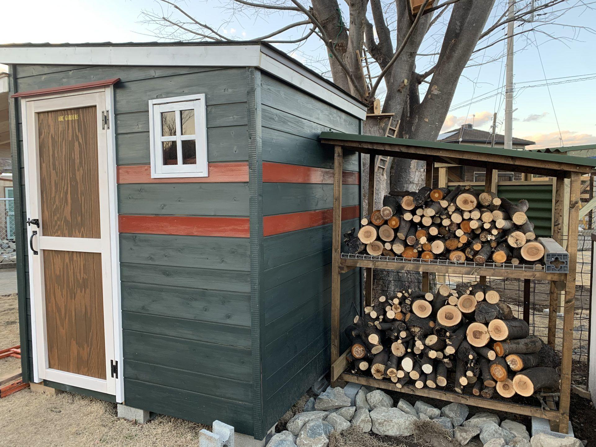 Wooden storage with firewood storage