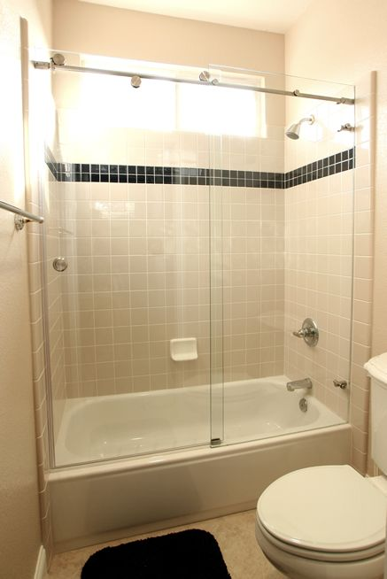 The glass doors with the tub make room look larger without division ...
