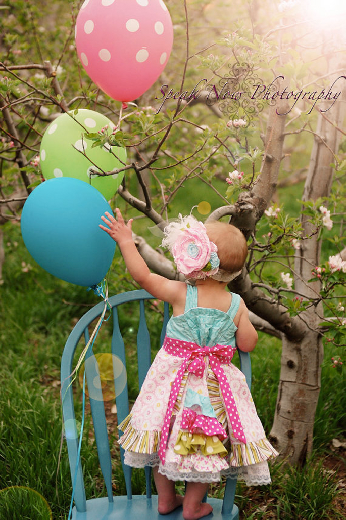 Love the dress, the headband, the balloons....all of it. Milly's 1st birthday pics maybe?