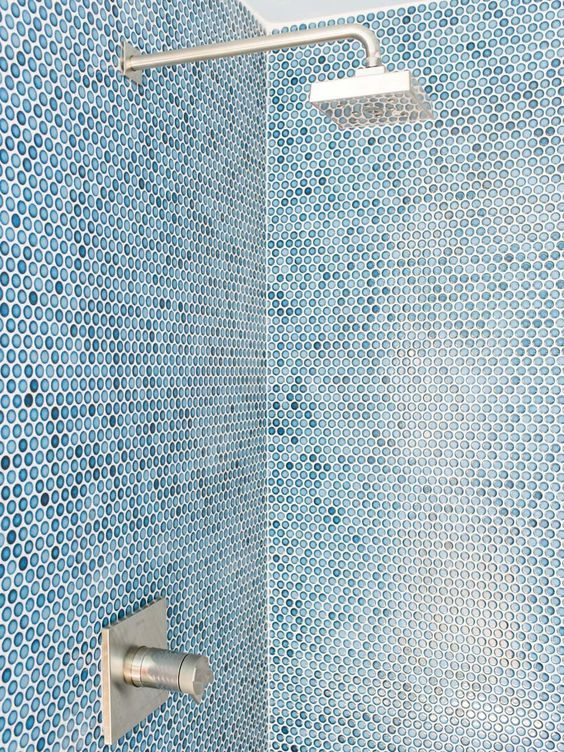 The Sharp Angles Of Shower Head And Water Valve Offers A Sleek Look Contrasts With Penny Round Tiles On Walls