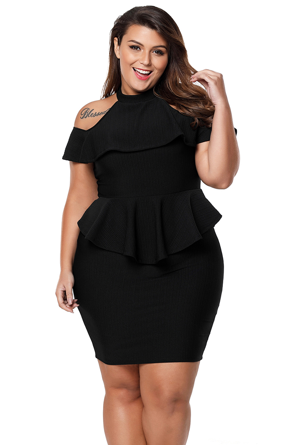 2ce2c0f0249 Ruffle layer top with cold shoulder detail. Flattering peplum waist in a  form hugging fit. Crafted by textured stretchy knit