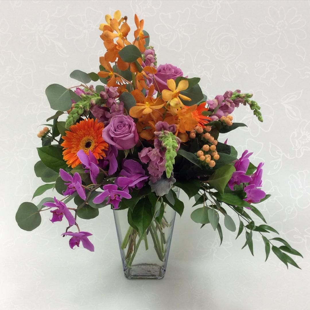 Sunny And Summery To Celebrate A Retirement Phalaenopsis Orchid Mokara Rose Tropical Floral Arrangements Large Floral Arrangements Flower Arrangements