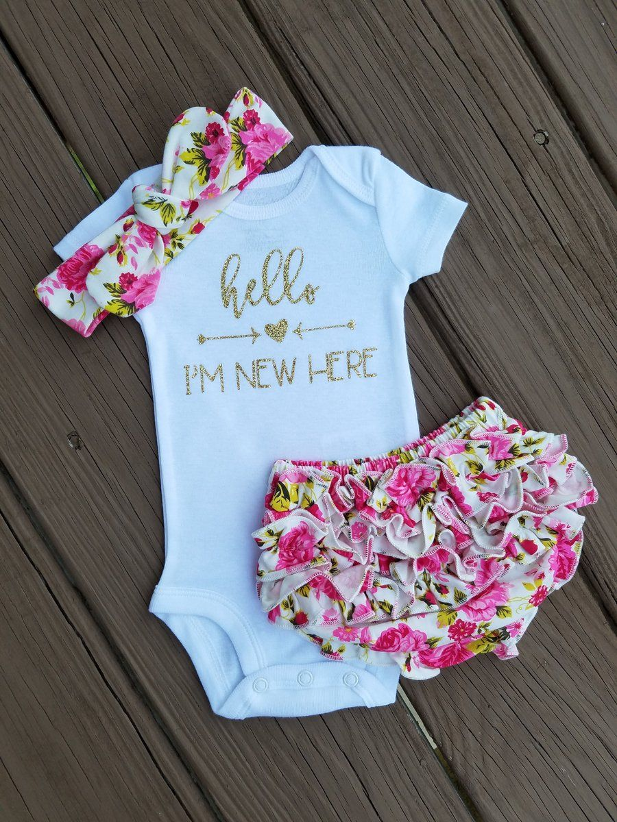 Dress your little princess up in this super cute pink and gold floral newborn take home
