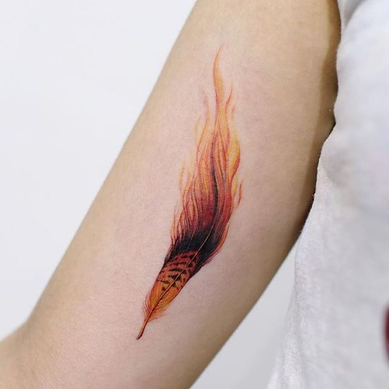 Flaming Phoenix Feather Tattoo On Inner Bicep Flame Tattoos Phoenix Feather Tattoos Feather Tattoos