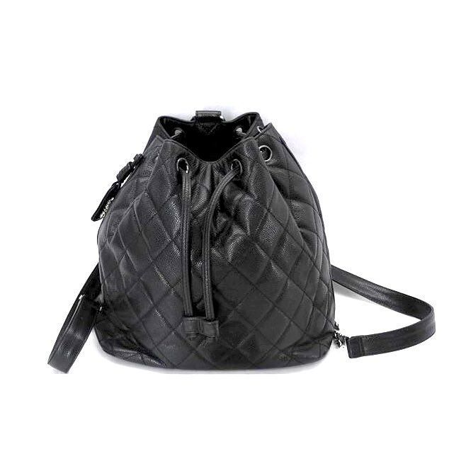 5dc30edd0ce7 Vintage Chanel bucket bag backpack quilted caviar leather Chanel gold hang  tag embellishes the top wear