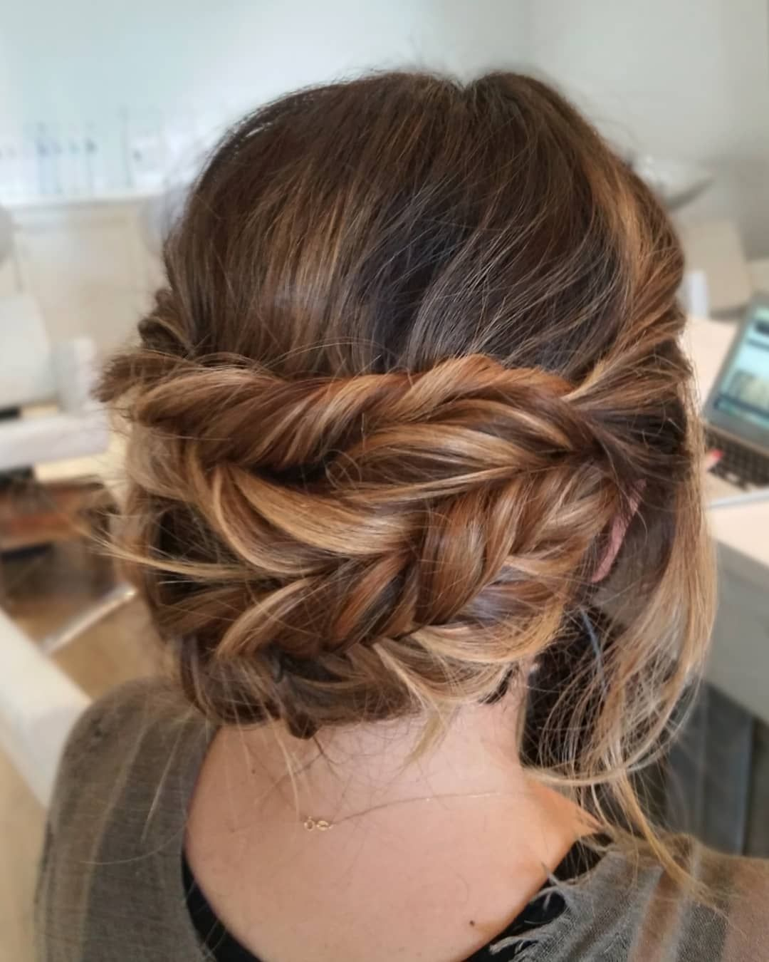 Beautiful Whimsical braided updo is perfect for any bride