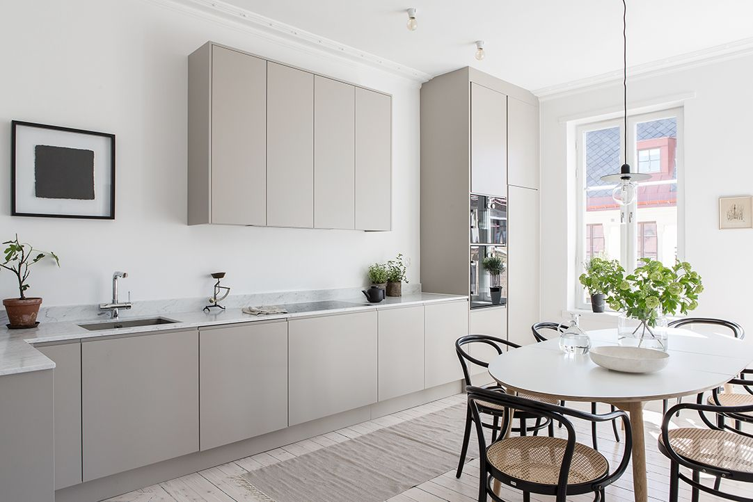 A Warm Grey Home Warm Grey Kitchen Marble Countertops And Gray - Warm gray cabinets