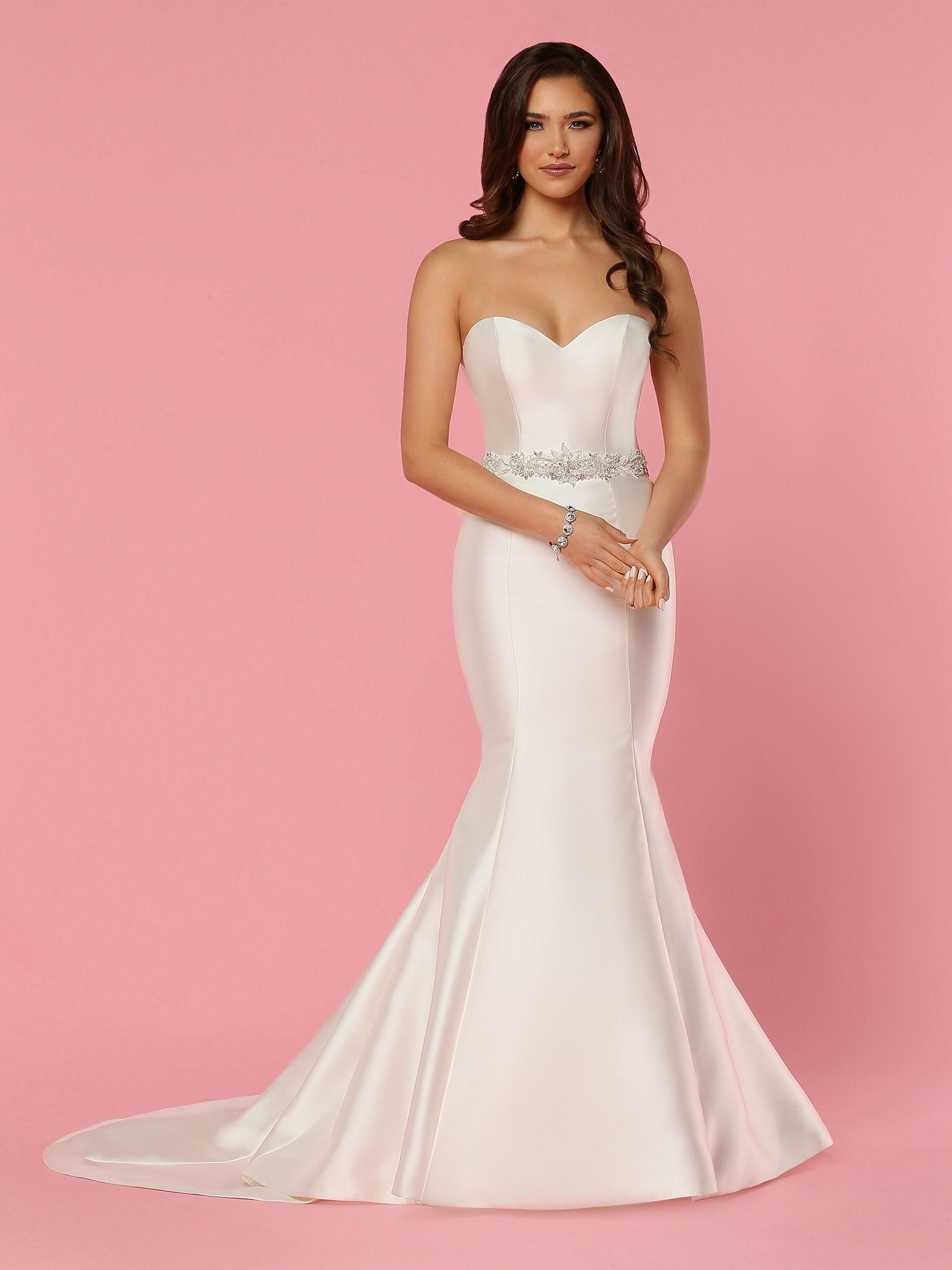 Be the vision of minimalist perfection in this strapless sweetheart ...