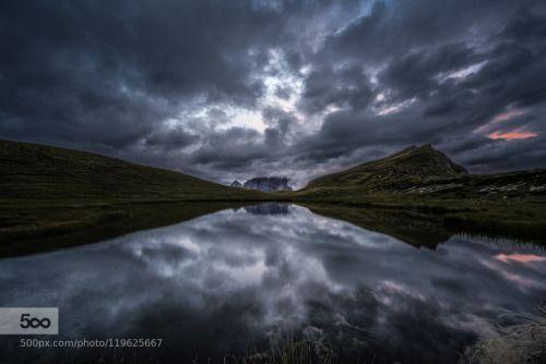 Angry Dolomites by mattiadattaro  clouds cloudy d750 dolomites dolomiti italia italy lake landscape mountain mountains nikon nikon d75