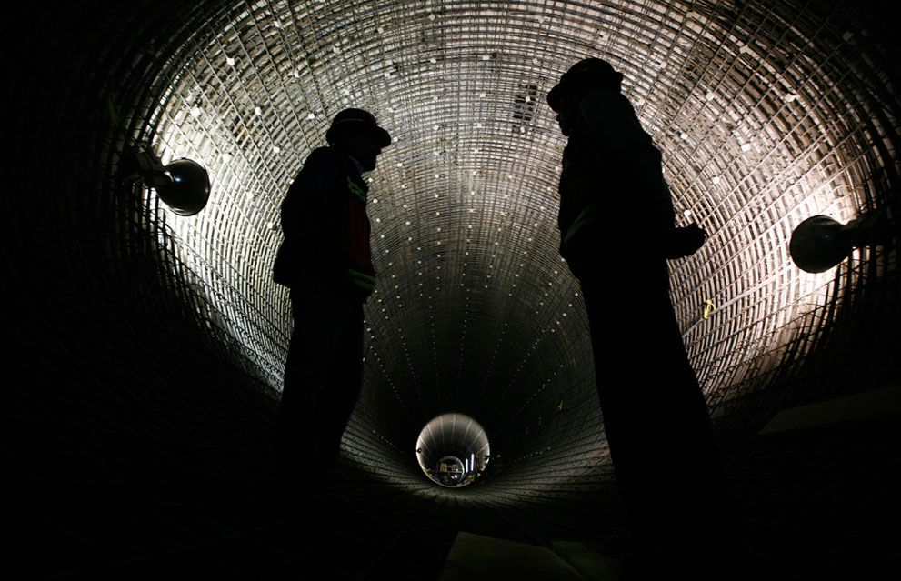 Workers stand in a new addition to the massive underground deep drainage tunnel system in Mexico City, on March 10, 2012